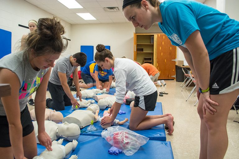 Students participate in a CPR class